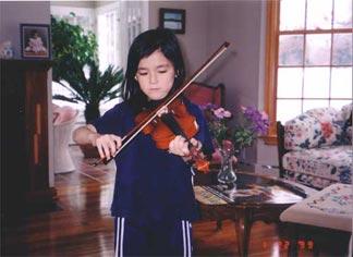 Yuki playing violin